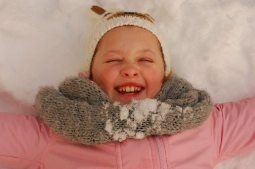 MGL Media - child playing happy in the snow image