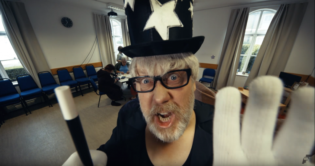 vic reeves dressed as a retired british wrestler, The Conjuror.